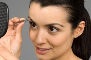 woman-tweezing-brows